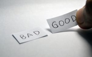 Two pieces of paper on a white background, one says bad the other good.