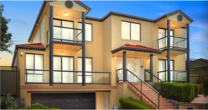 Photo of two storey yellow rendered home