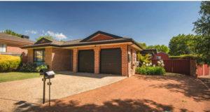 Photo of red brick one storey home